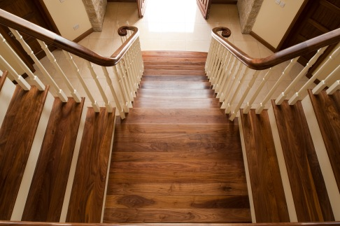 Grand entrance split flight walnut staircase