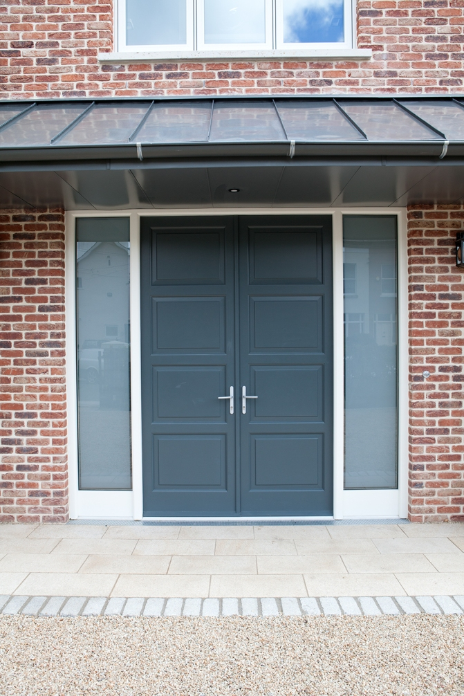 Four panel double front doors and screen