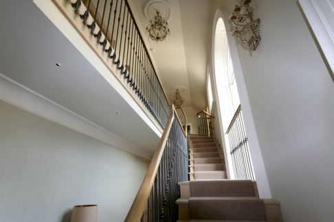 Classic staircase with wrought iron balusters
