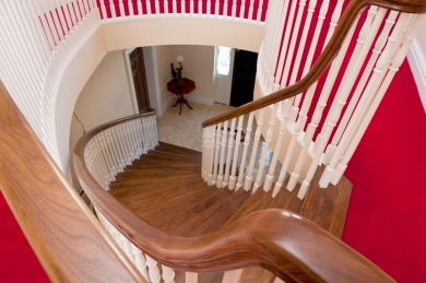 Curved walnut staircase