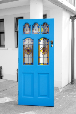 Bright blue stained glass door
