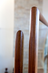 Circular walnut handrail with mitre joint