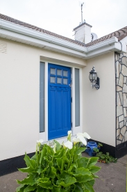 Deep blue front entrance door and screen