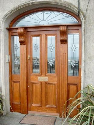 Front entrance door and screen with arched fanlight