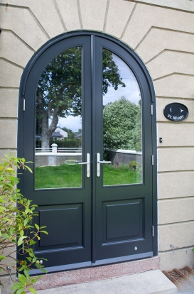 Arched front entrance doors