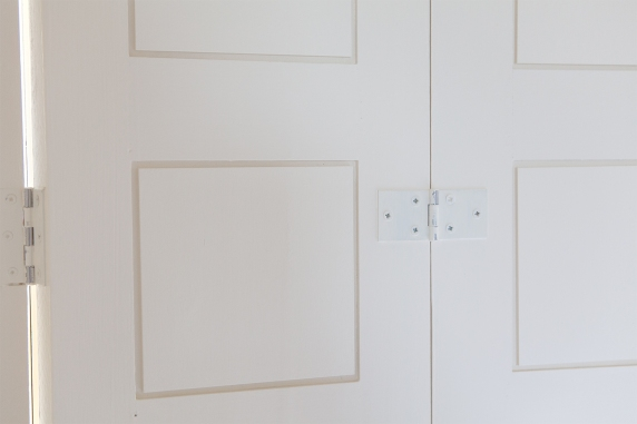 Three panel folding shutter in closed position