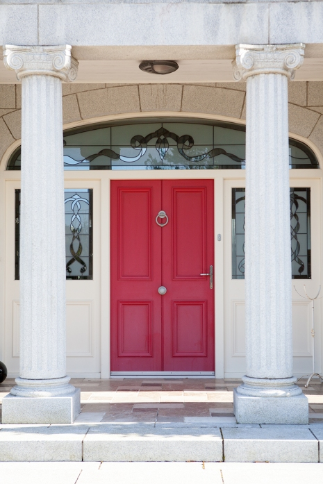 Ruby red door and screen with arched fanlight