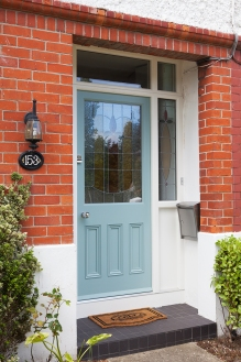 Light blue front entrance door and screen with stained glass