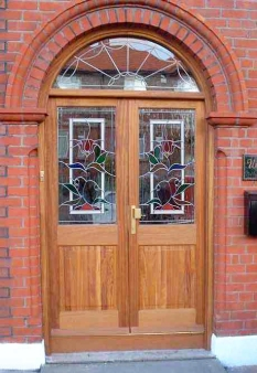 Double front doors with arched fanlight