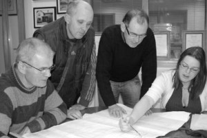 Jem, Philip, Joe & Grace in 2009 reviewing architect's drawings.