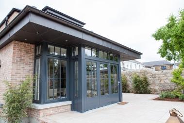 Corner window and bi-fold door