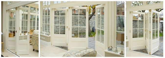 Conservatory with white bi-fold door