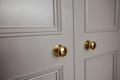 Two panel internal double door with brass knobs