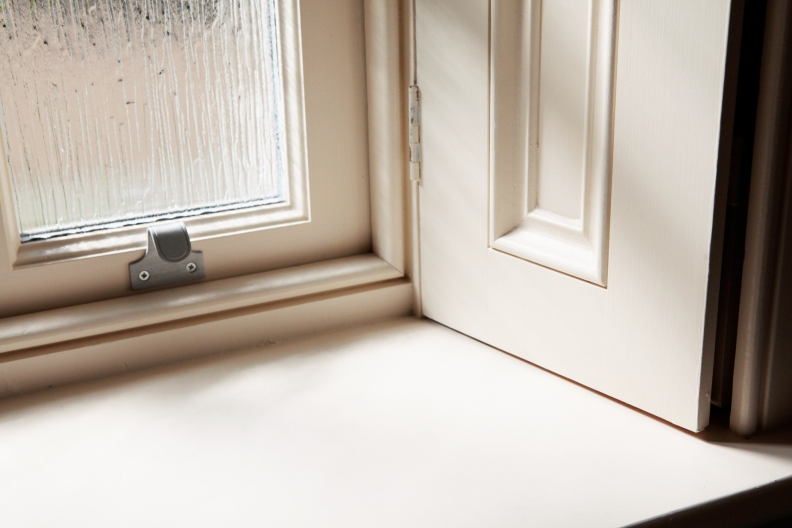 Stainless steel hardware on sliding sash window with shutters
