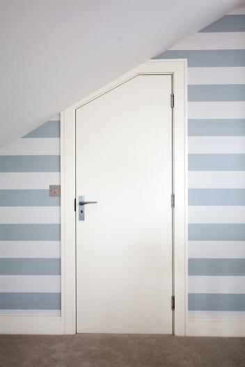 Splayed flush door and frame