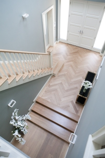Entrance hallway with steps, front doors, internal doors and staircase all by McNally Joinery