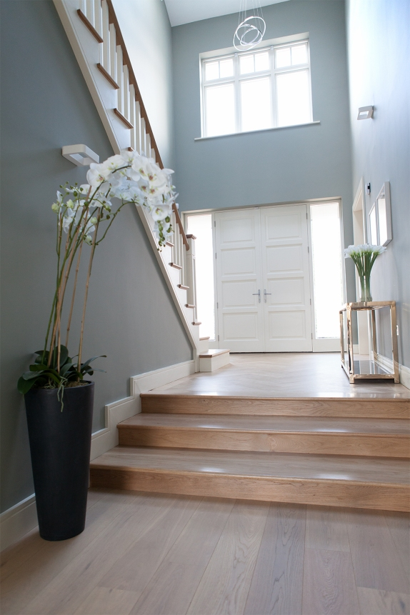 Entrance hallway featuring McNally Joinery steps, front door and staircase