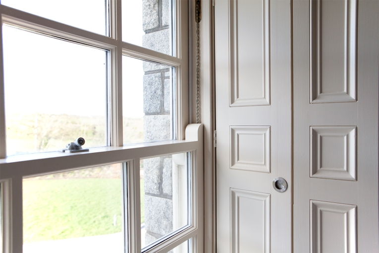 Panelled shutter for sliding sash window