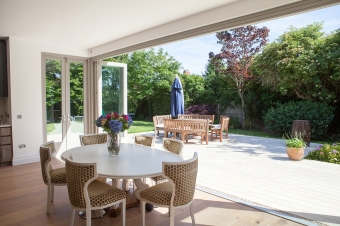 Seven leaf bi-folding door in the open position #openyourhome