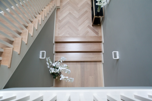 Oversized white oak treads for entrance area