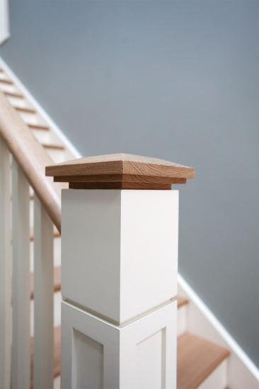 Oversized square poplar newel post with white oak cap