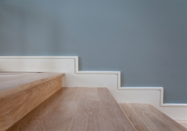 Oversized white oak treads and white skirting