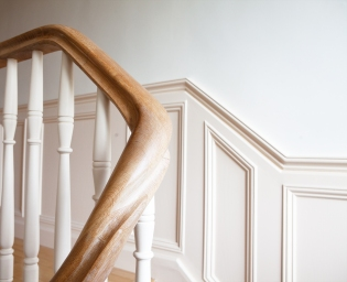 Wall panelling, continuous curved handrail and spindles