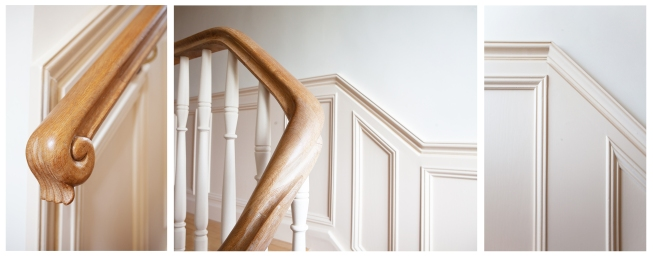 Oak handrail, cream spindles and wall panelling